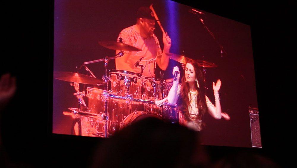 Jam Hot singer & drummer on large festival screen