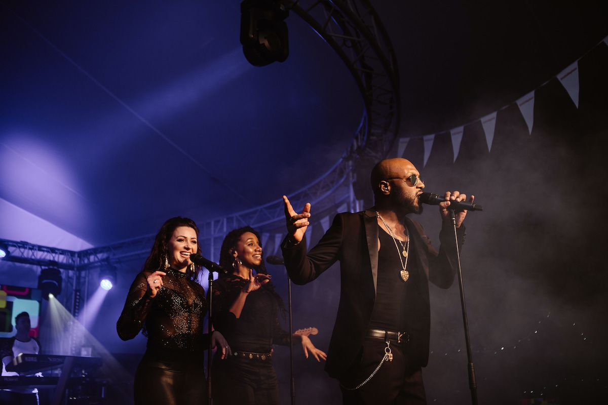 Jam Hot singers on stage at a festival