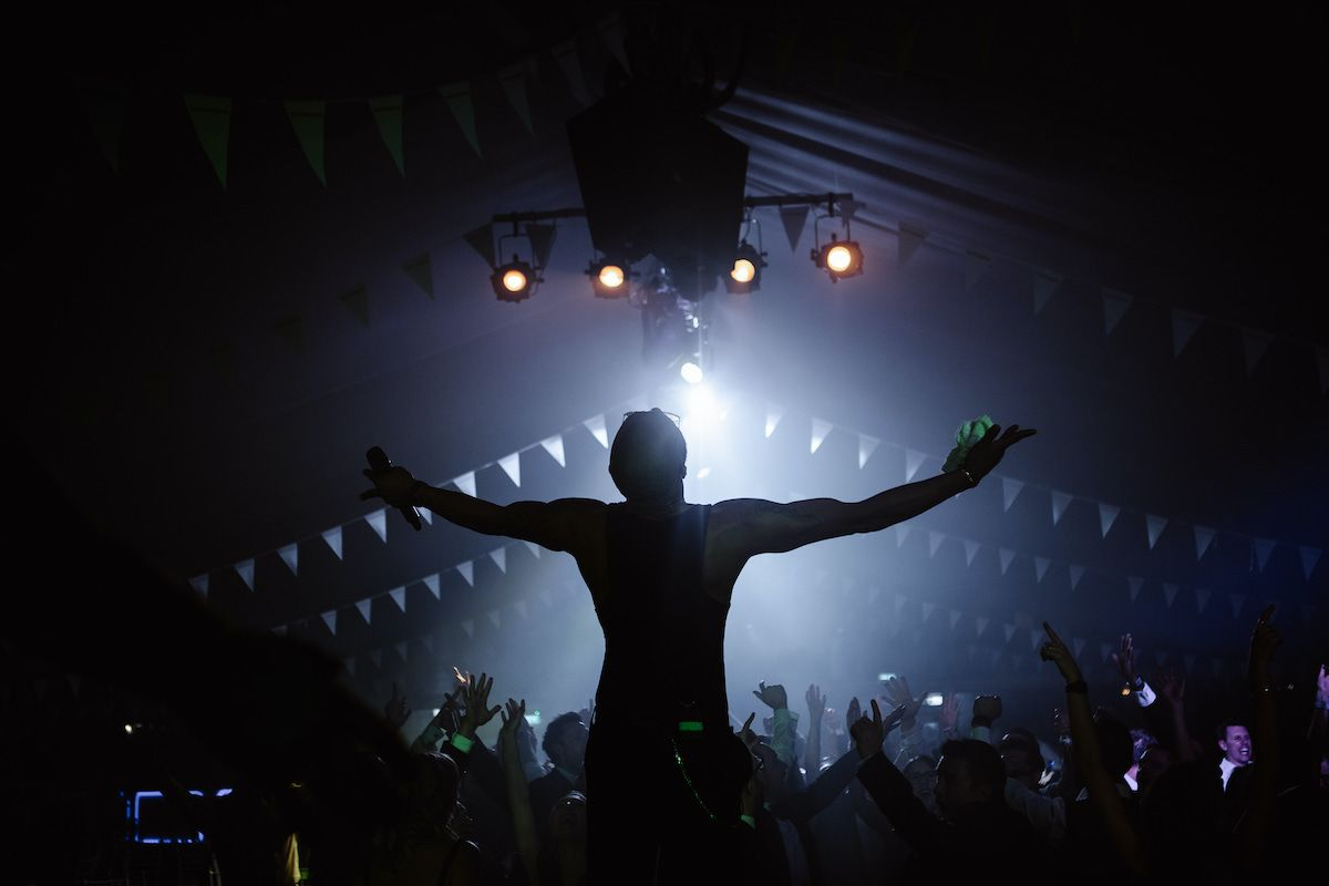 Silhouette of Jam Hot singer infront of festival crowd