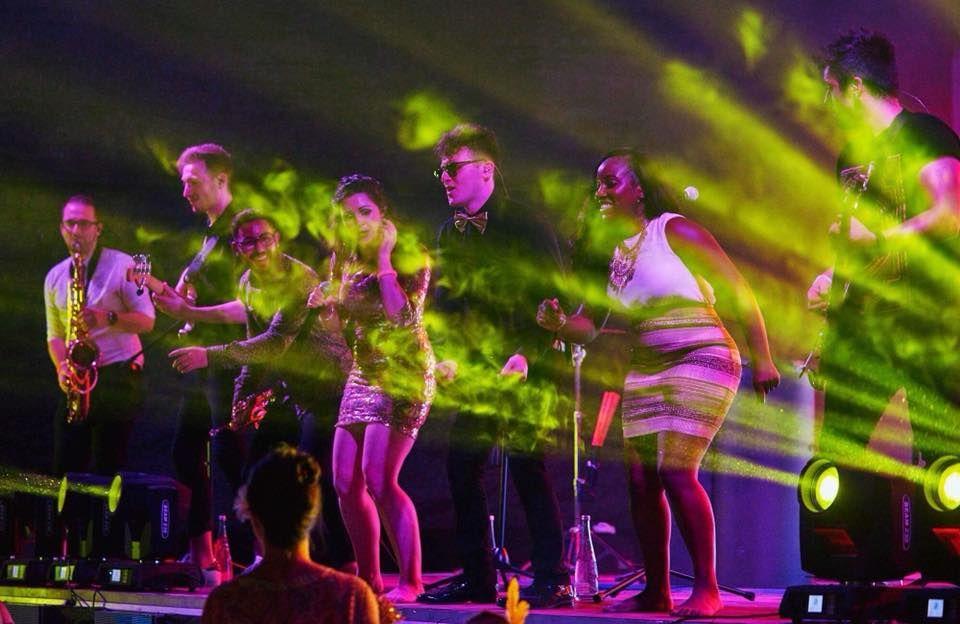 Jam Hot perform at a Beach festival