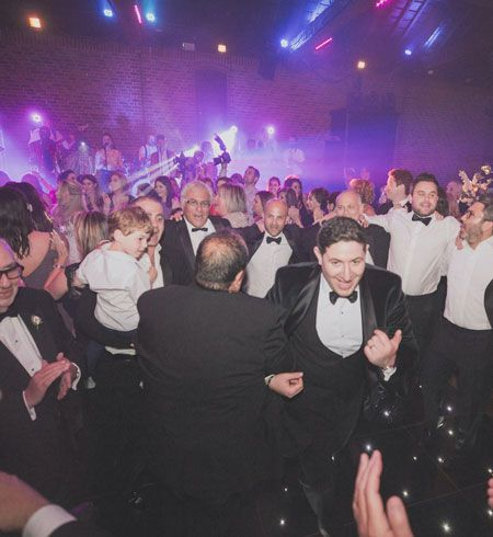 Jam Hot Jewish Wedding Band performing to a busy dance floor