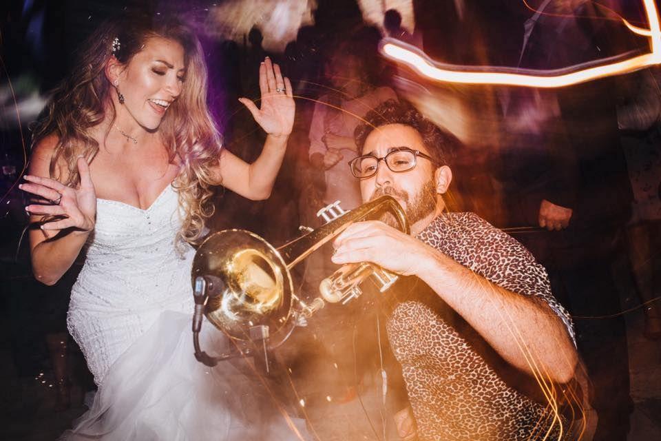 Jam Hot trumpet player joins bride on the dance floor