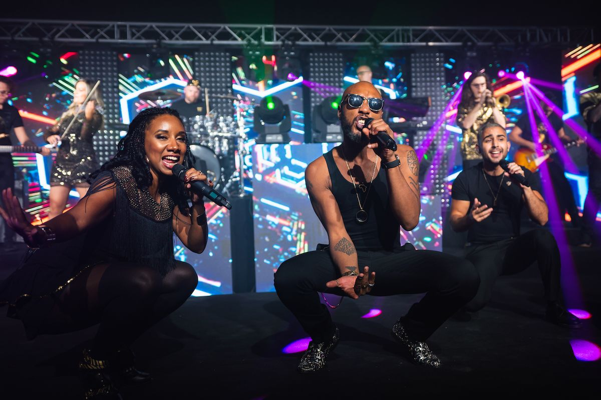 Jam Hot singers crouch whilst performing 21 seconds at a Jewish Wedding