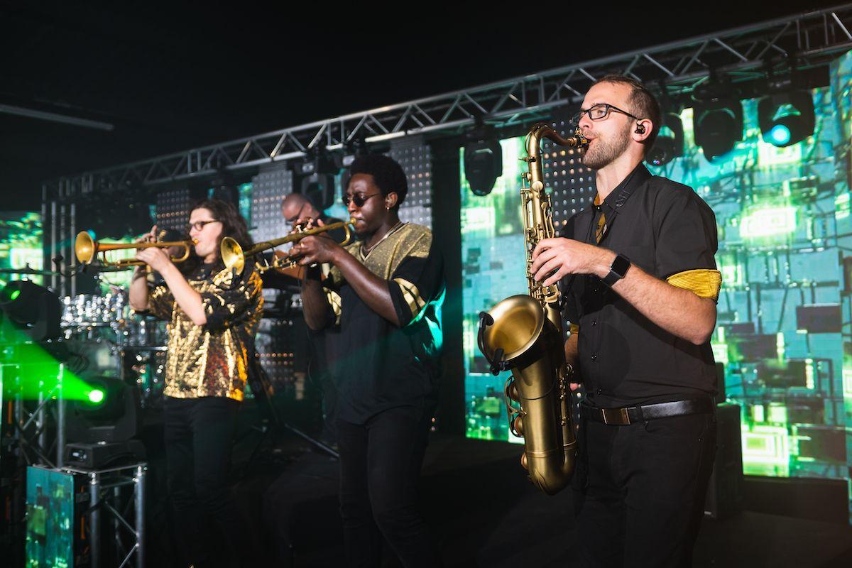 Jam Hot horn section wearing urban gold