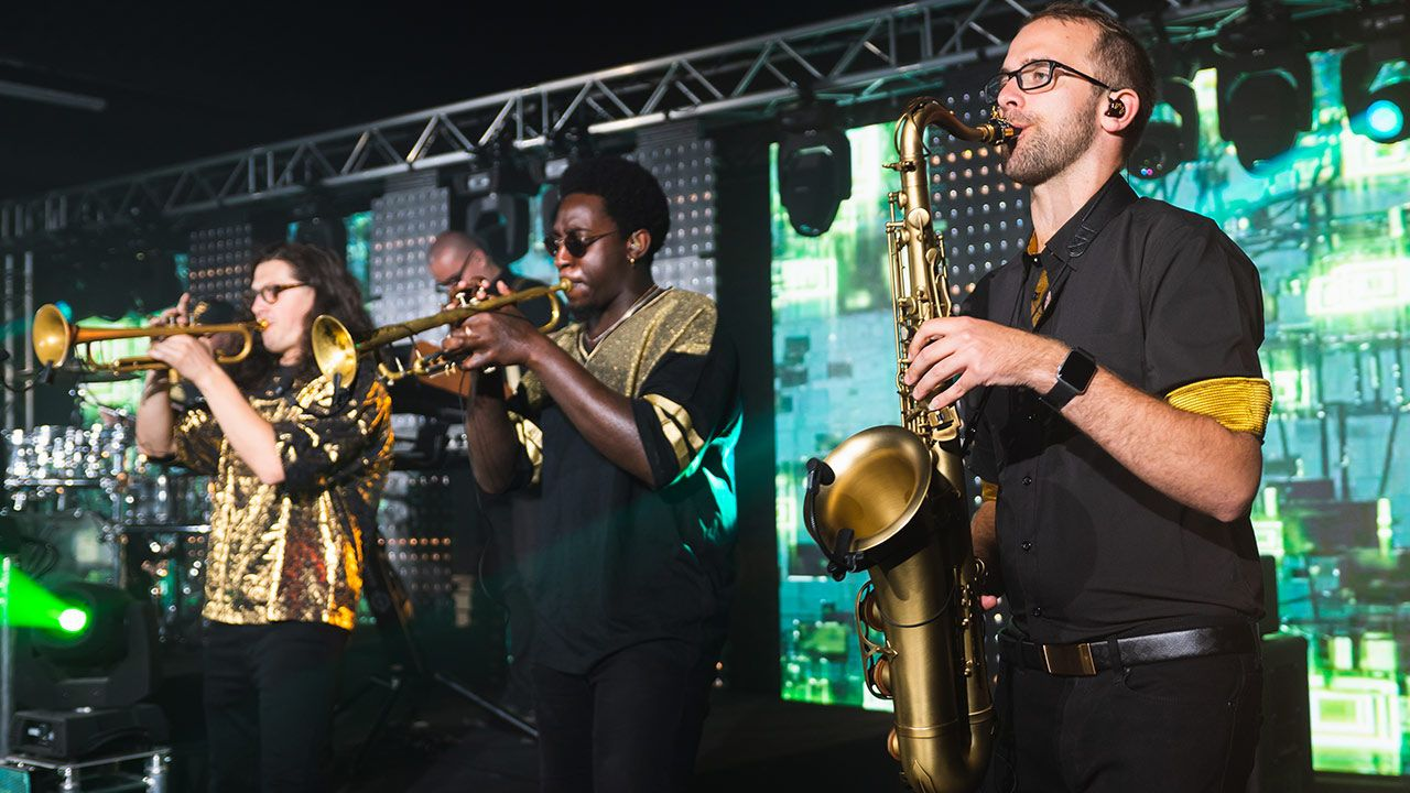 Big-Ass Brass Band perform on stage