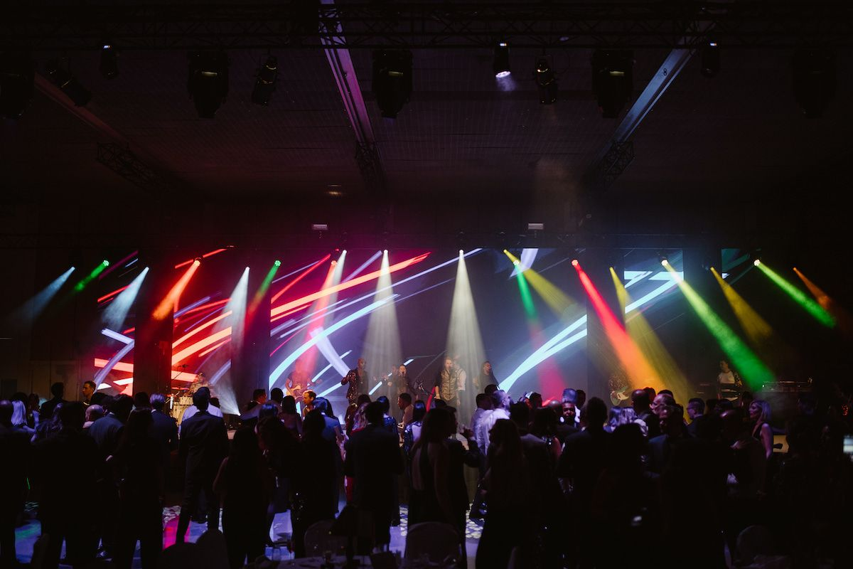Jam Hot showband live on stage with multicoloured lighting