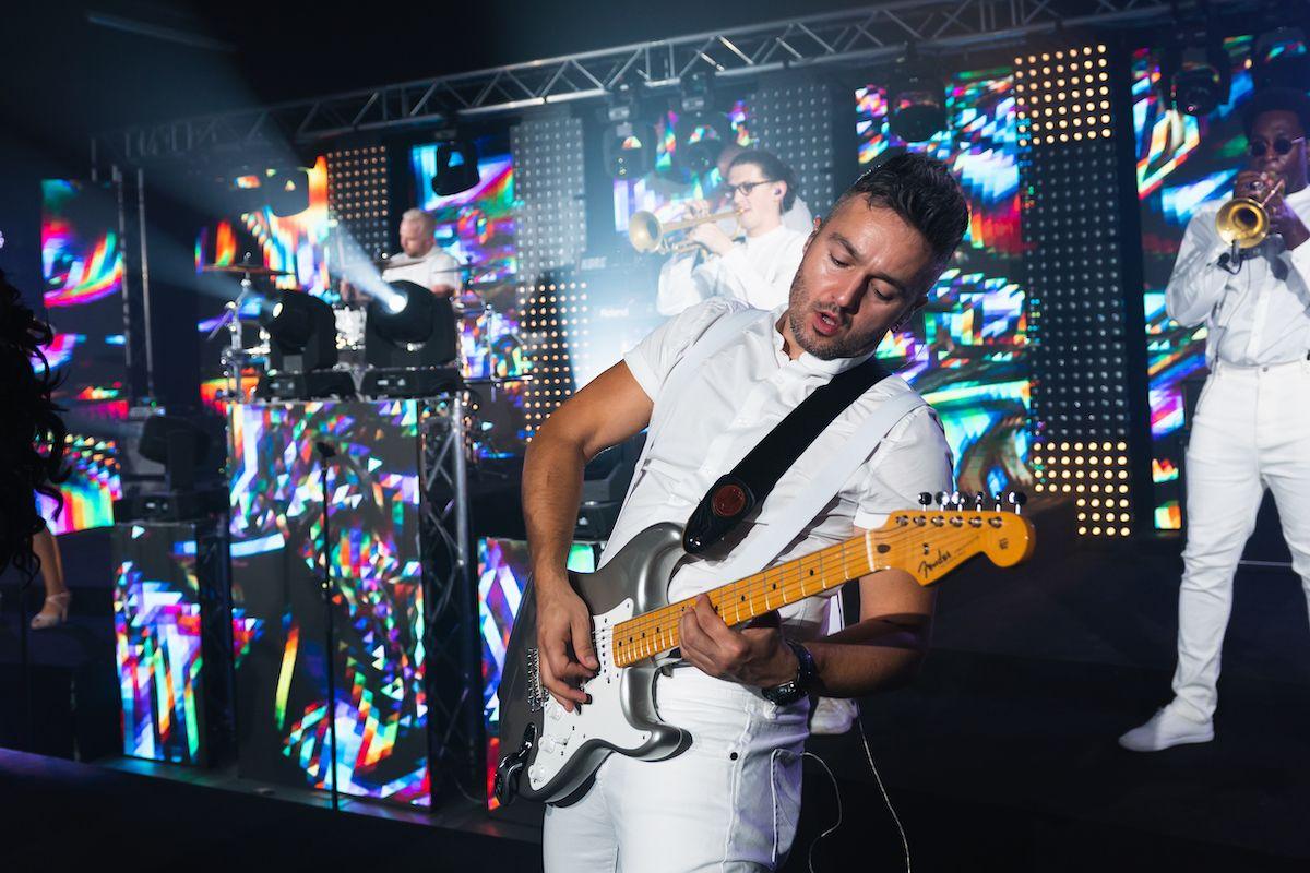Jam Hot showband live guitarist on stage