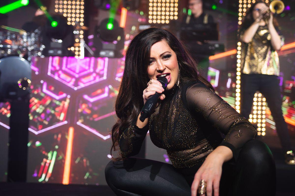 Jam Hot showband singer performing on stage