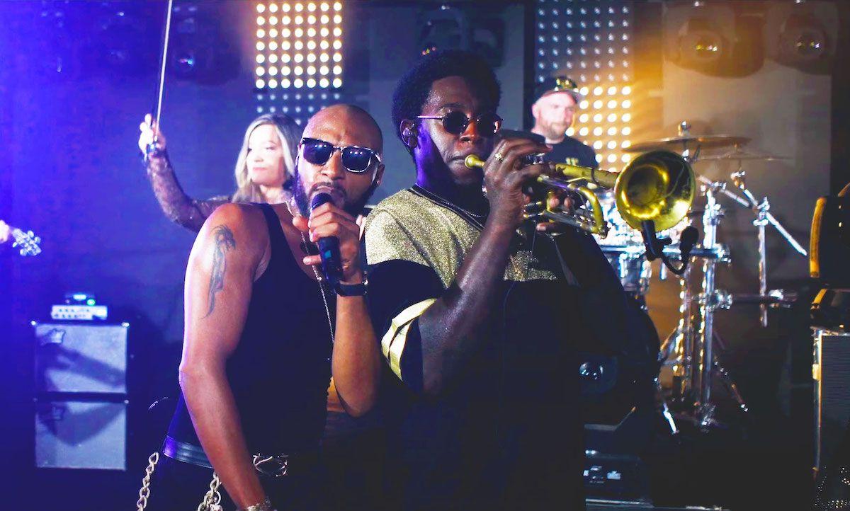 Jam Hot showband live trumpet player and singer perform together