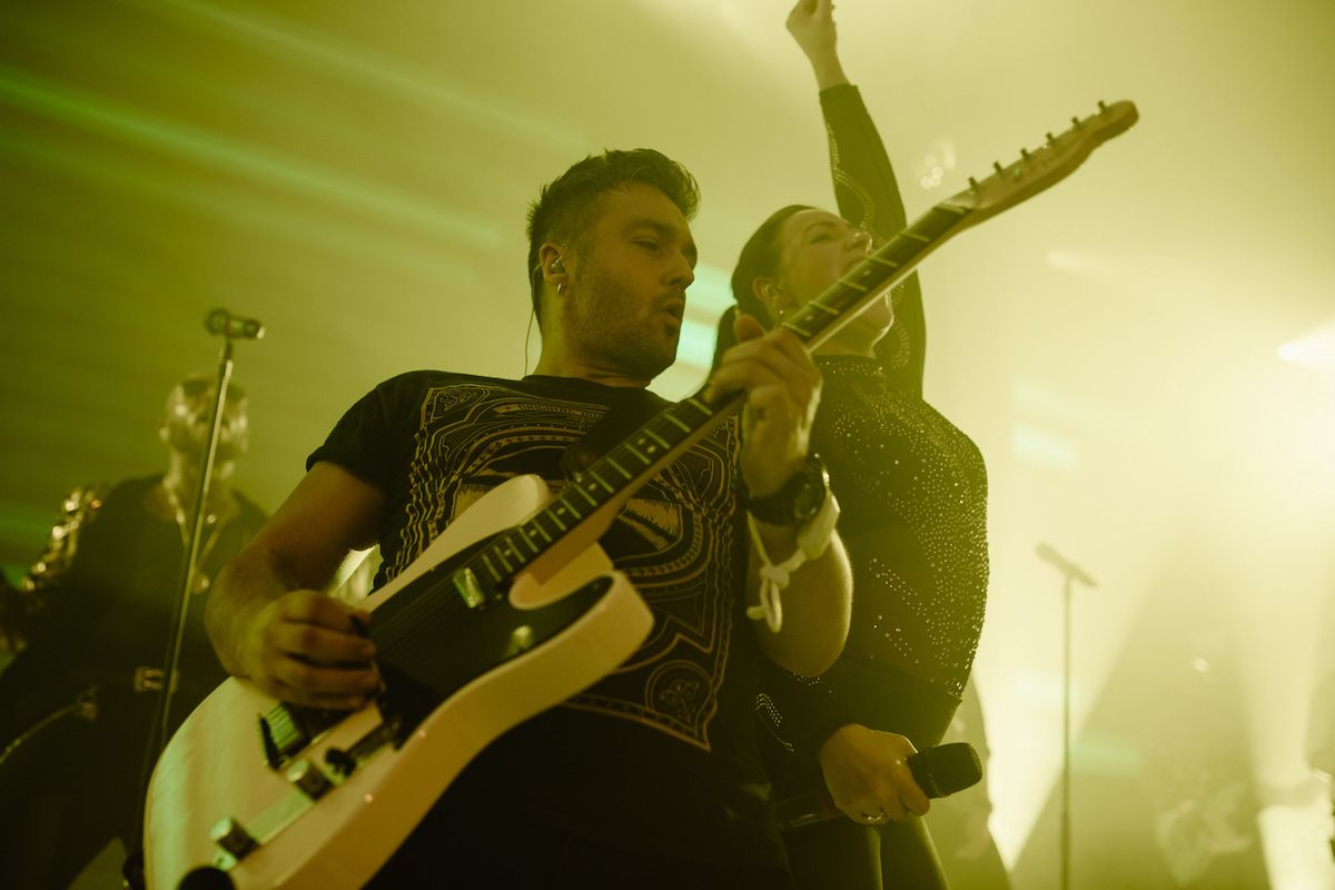 Jam Hot showband live guitarist and singer on stage