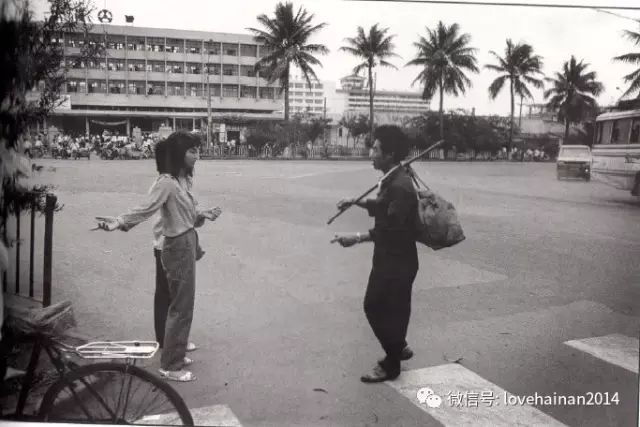 A student gives directions to a traveler outside Haikou Bus Station Now Mingzhu Plaza 1990