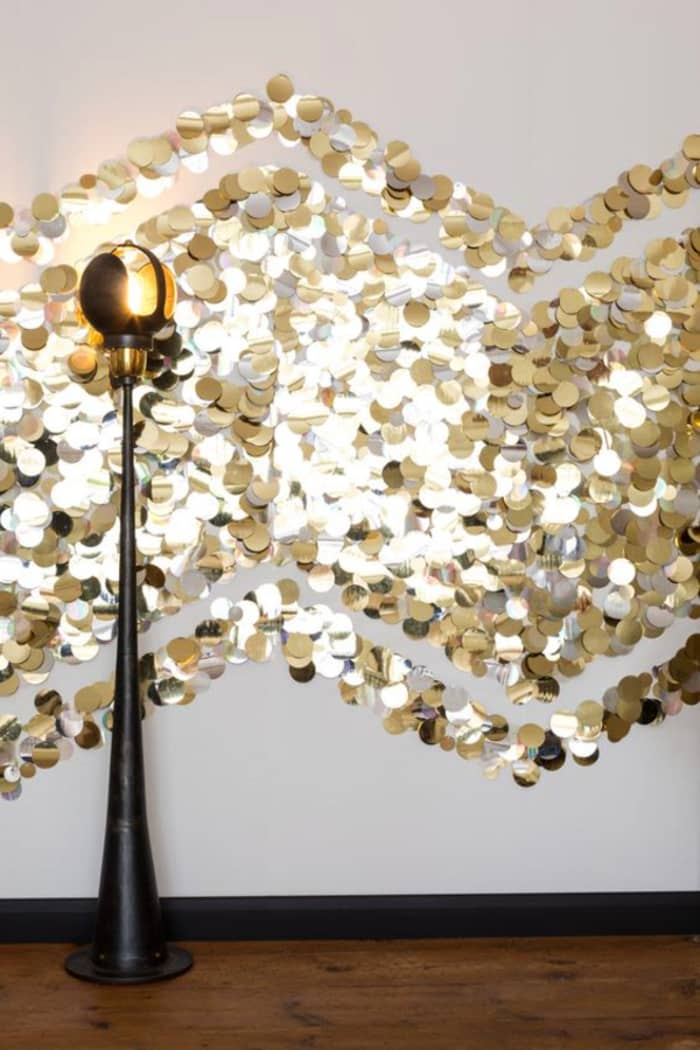 Gold sequin wallpaper on white wall, by Tracy Kendall.