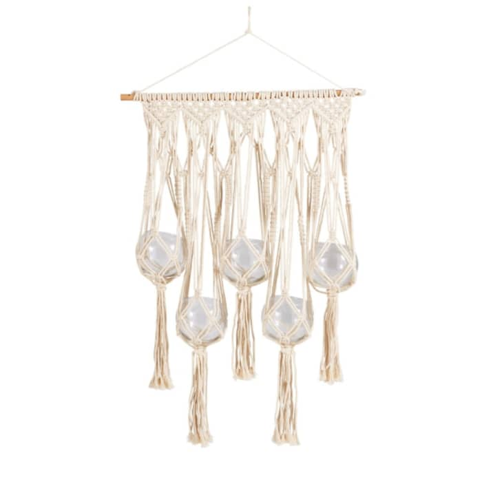 Hanging macramé with glass vases.