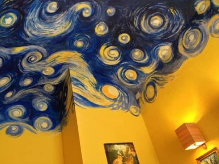 "Ceiling reproducing Van Gogh's ""Starry Night"" painting."