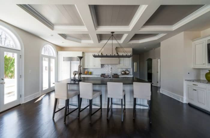 Modern kitchen with white coffered ceiling. The coffers are panelled and painted in grey.
