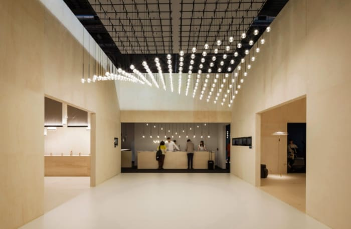 Pendant light ceiling configuration. The lights, installed at different heights, look like a wave.