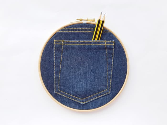 Denim pocket framed into an embroidery hoop.
