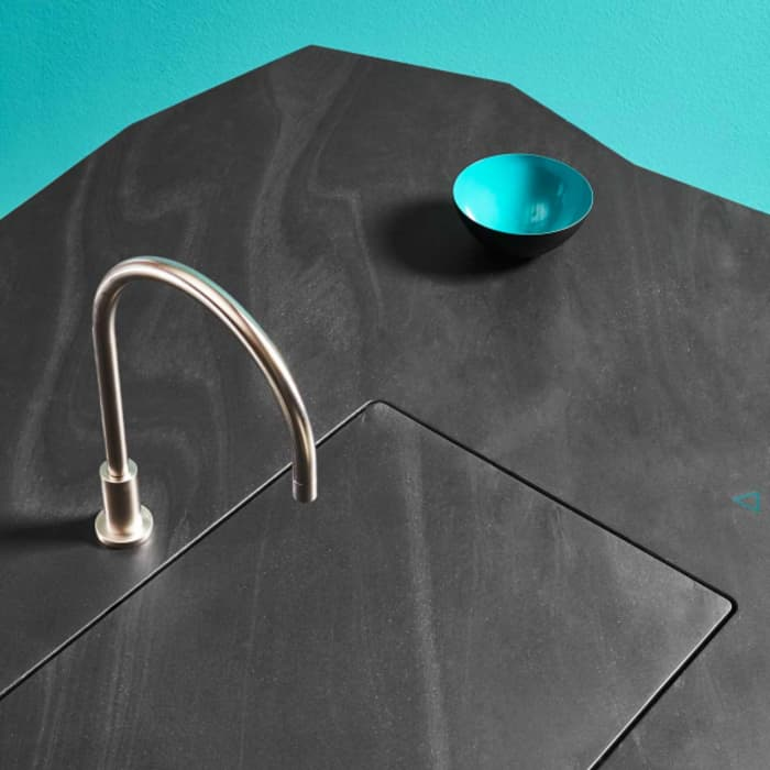 Gesture-controlled kitchen sink, that lowers automatically leaving an invisible kitchen.