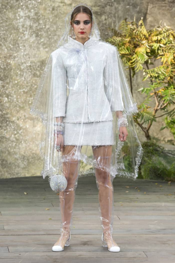 Clear plastic cape and boots, by Chanel.