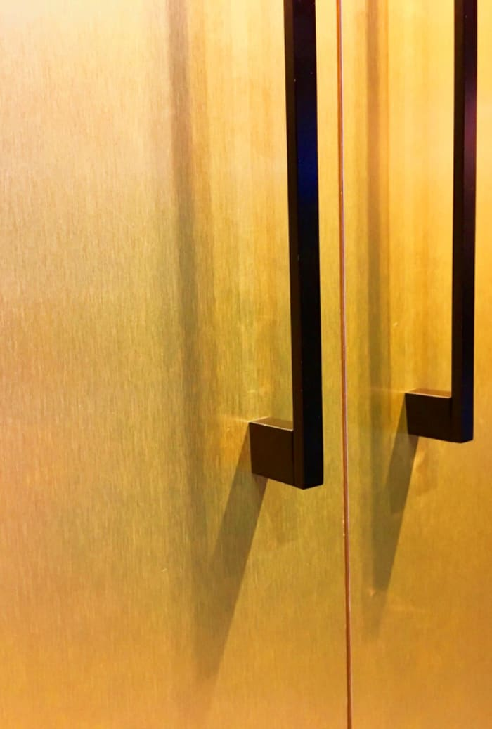 Close up of the gold fridge door.