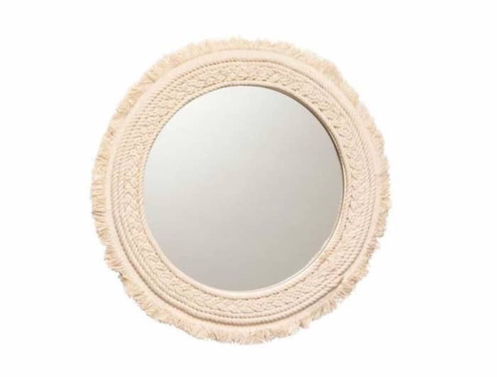 Fringe round mirror, by H&M Home.