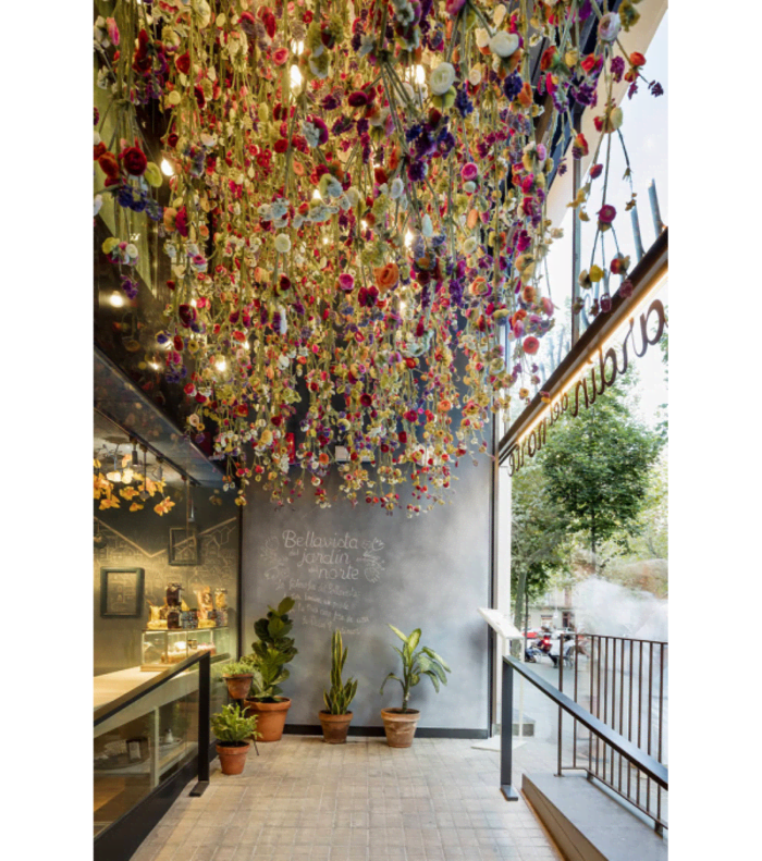 Restaurant entrance with thousands of colourful tulips hanging from the ceiling.