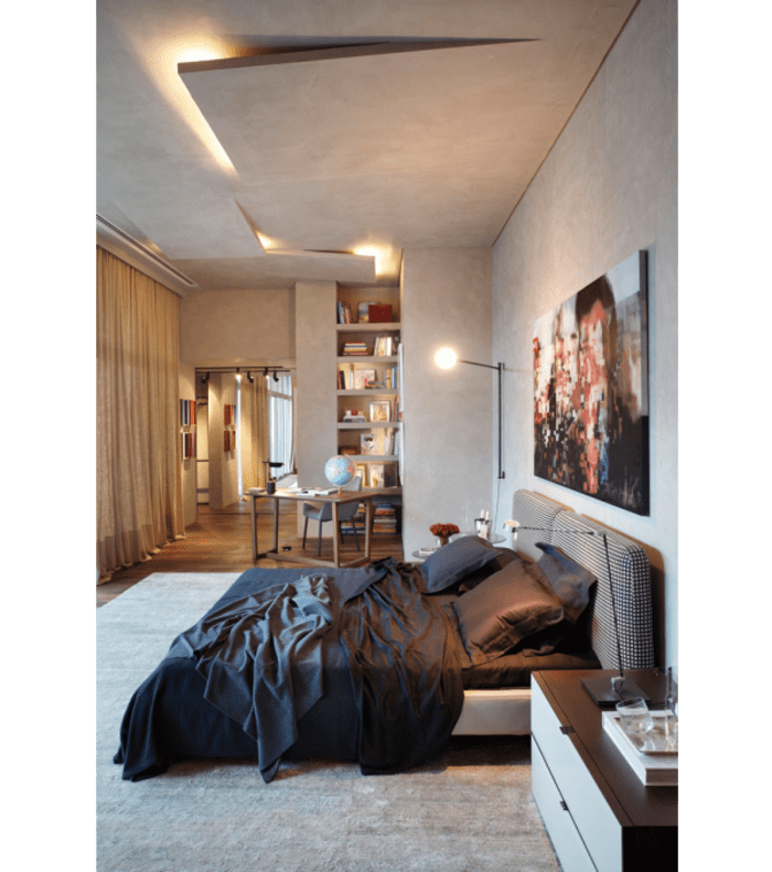 The concrete ceiling in this bedroom seems sliced and thus conceals the lighting body.