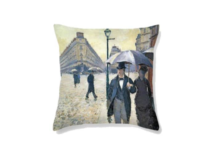 """Cushion printed with a detail of the painting of Gustave Caillebotte """"Paris Street Rainy Day"""", by Fine Art America."""
