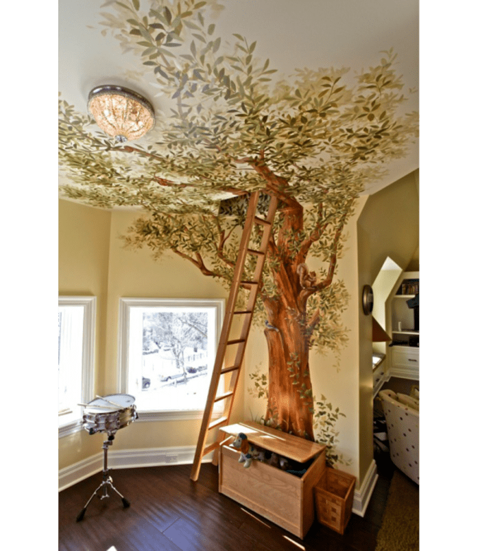 Trompe l'oeil mural of a tree covering the wall and part of the ceiling.