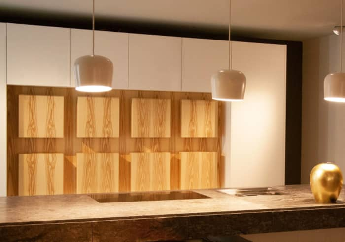 Invisible kitchen cabinets become a design feature.