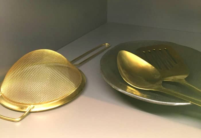 Another simple way to embrace the gold kitchen trend. Gold kitchen utensils.