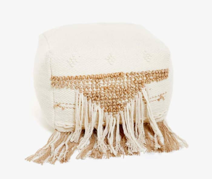 Cube pouf with fringe and knots detail on the front, by Zara Home.