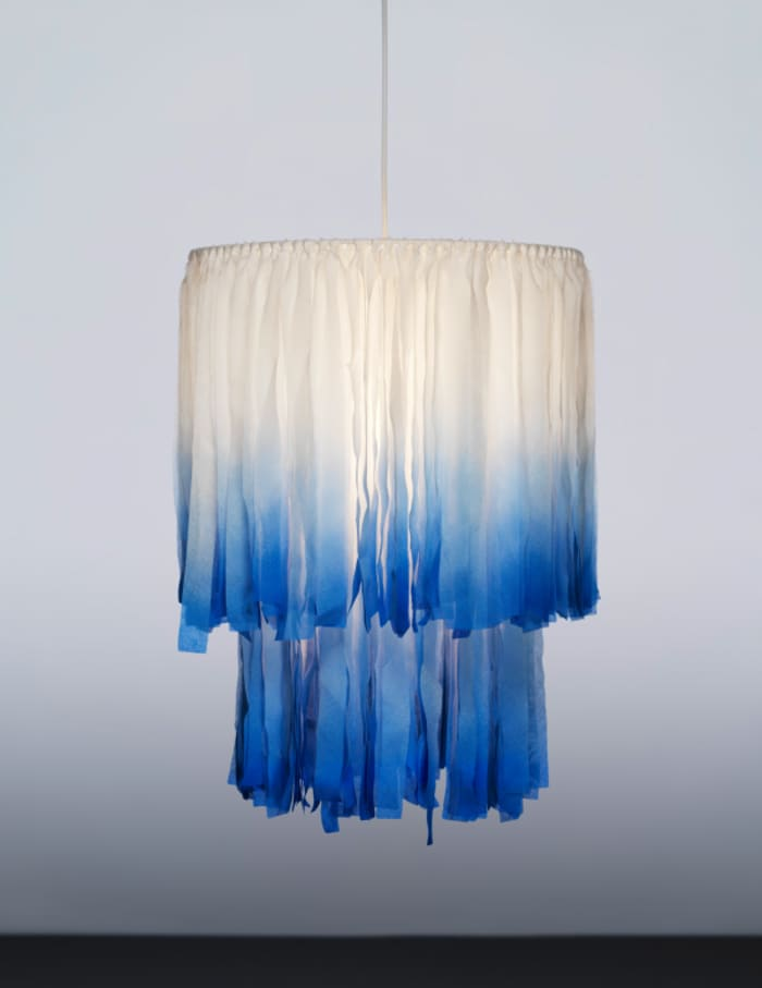 A sustainable chandelier from TÄNKVÄRD collection, made of sustainable textile pieces.