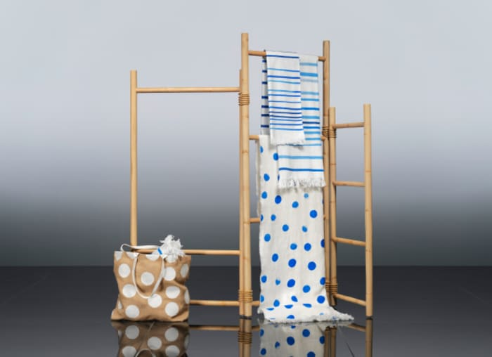 A room divider and textiles from TÄNKVÄRD collection, all made out of sustainable materials.