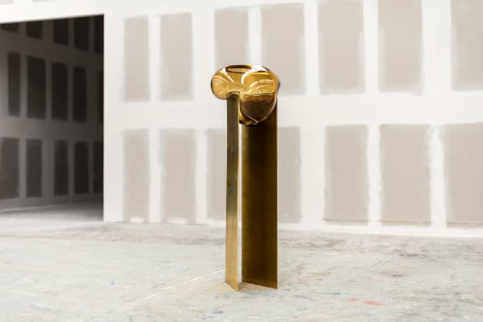 The Precarious vase, made of blown glass and brass