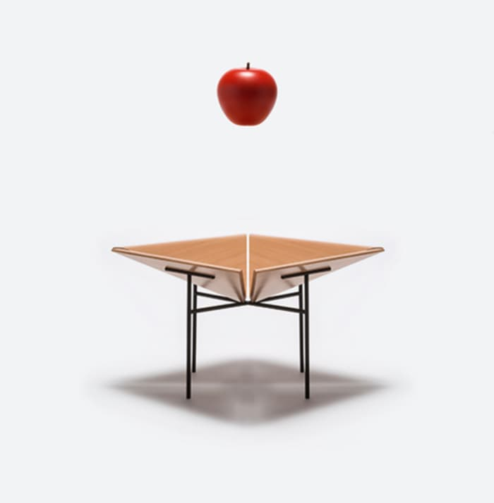 Fruit bowl no.11, a minimalist container by Danese Milano, made of a wooden bowl and thin metal legs.