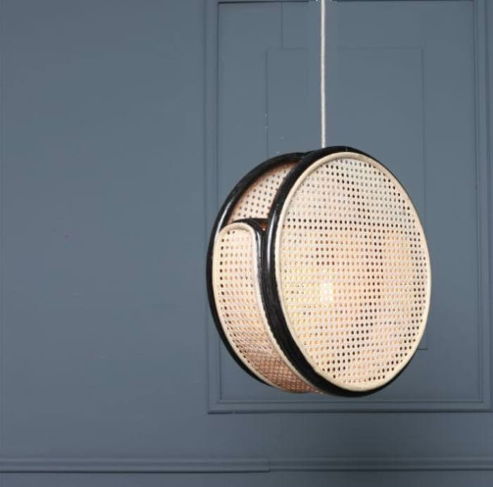 Bent pendant light, example of modern Vienna straw design by Light Cookie from Etsy.