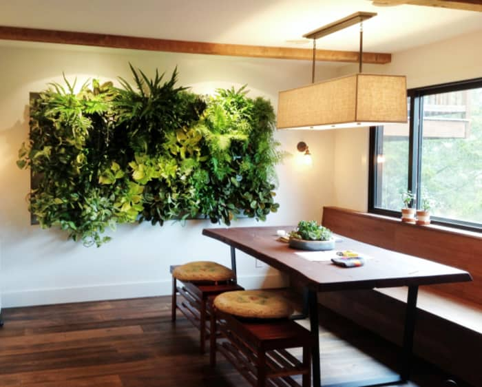 Garden wall design as a hanging artwork in a dining area.