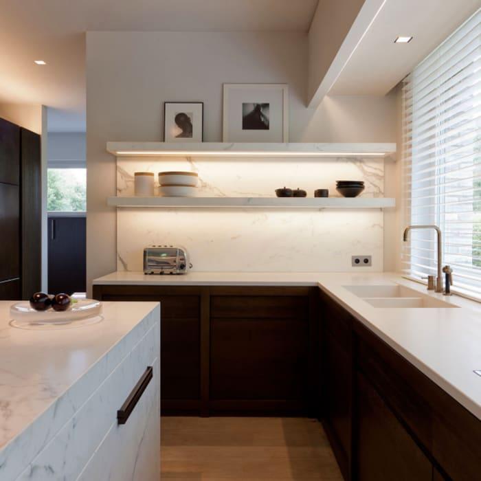 Minimalist kitchen design with lit shelves.