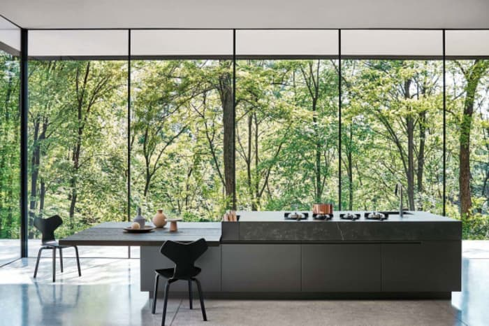 Modern kitchen with view to the outdoors, great example of biophilic design.