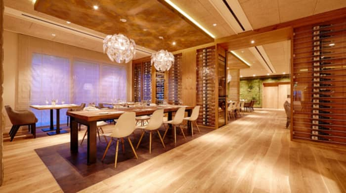 Modern restaurant design with clear wood curved flooring.