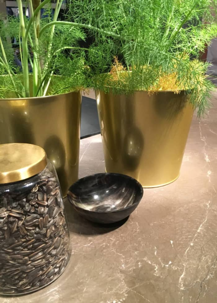An example of functional use of gold in the kitchen. Gold herb containers.