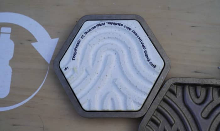 Close-up of a tile from Trashpresso, baked from plastic waste