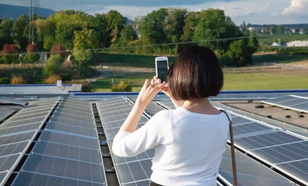 Me taking a photo of solar panels on the roof of IKEA's Aubonne, a champion store for sustainability.