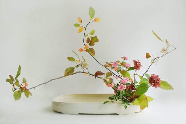 Ikebana arrangement made of local leaves and flowers.