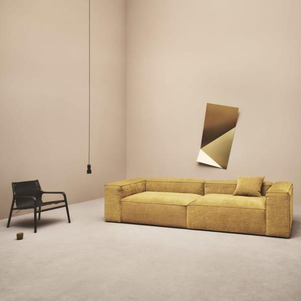 Mustard yellow sofa.
