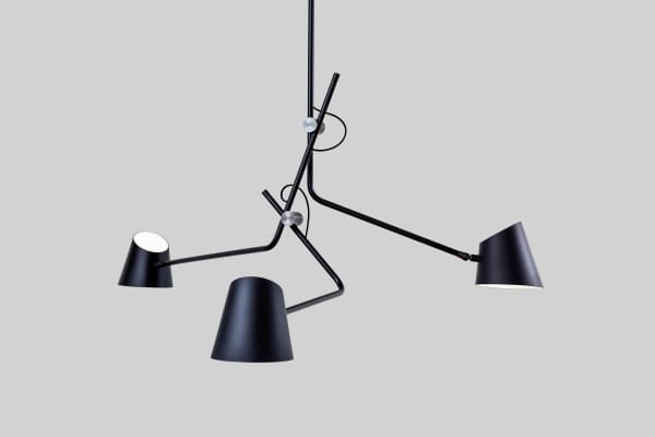 Sculptural pendant lamp with three arms.