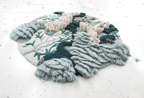 Textile art reproducing coral reefs - perfect for a biophilic design.