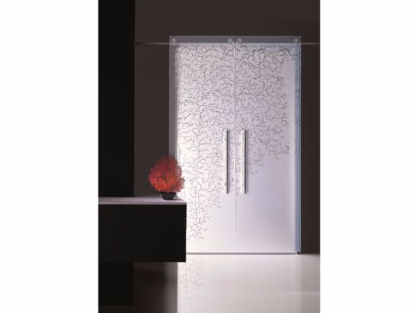 Sliding door with a coral patter impressed, great example of biophilic design.
