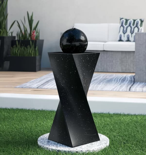 Small water fountain, perfect addition to a small space to create a biophilic design.